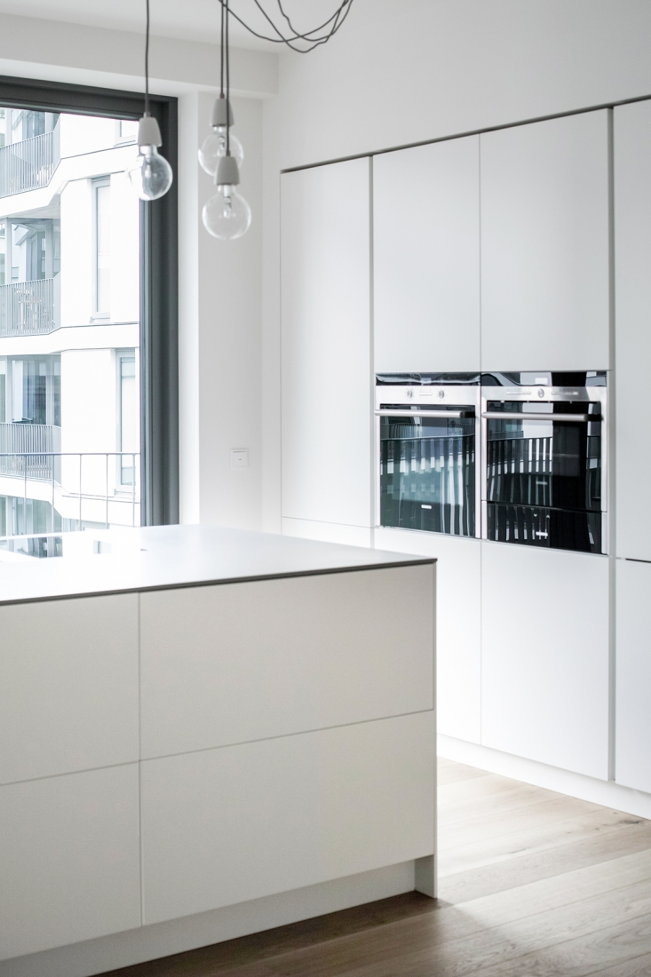 This Simple White Kitchen Located In Friedrichshain, Berlin Was Supposed To  Become The Center Piece Of The Apartment. The Client Wanted A Spacious  Feeling ...